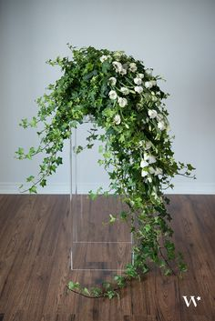 potted ivy with white flowers inserted- easy decor for fireplaces or on the terrace banister at laurel hall