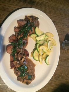 Rib-eye Pork Chop with our rich Spinach Marsala Sauce