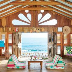 The Living Room - Bohemian Jamaican Beach Cottage - Coastal Living Perched right on Frenchman's Bay, an island hotelier's colorful home is filled with vibrant textiles, local treasures, and thrifty accents. Bohemian Living Rooms, Cottage Living Rooms, Coastal Living Rooms, House Rooms, Cottage House, Beach Cottage Style, Beach Cottage Decor, Coastal Cottage, Cottage Ideas