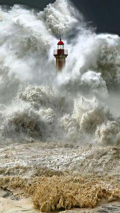 Amazing! Massive waves engulf a lighthouse.