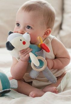 Our handmade organic soft cotton dolls each have a solid beech wood ring perfect for teething, a crinkly shape that jiggles when pulled, super soft crinkly ears, and colorful ribbon tabs. Baby Activity Toys, Infant Activities, Best Baby Toys, Baby Co, Fun Baby, Organic Baby, Organic Cotton, Sensory Toys, Bear Toy