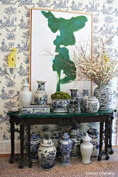 Chinoiserie video generate loaded with blue & white porcelain,mingling with a leopard carpet, emerald abstract art & yellow foo dogs Mais Blue And White China, Blue China, Leopard Carpet, Grey Carpet, Devine Design, Keramik Vase, Blue Rooms, White Rooms, Chinoiserie Chic