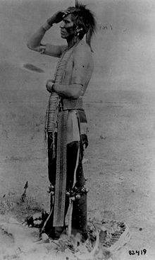 Assiniboine man, Montana, ca. 1890-1891.Traditionally Assiniboine people were semi-nomadic. During the warmer months, they followed the herds of bison for hunting—preserving the meat for winter. They hunted on horseback using bow and arrows. The tribe is known for its excellent horsemanship. They first obtained horses by trading with the Blackfeet & the Gros Ventre tribes. They did a considerable amount of trading with European traders in the fur trade