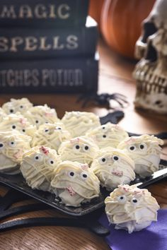 Are you looking for a tasty treat that's also cute this Halloween? These Mod Podge mummy truffles fit the bill - and HERSHEY'S Candy Corn Creme Bars make them delicious!