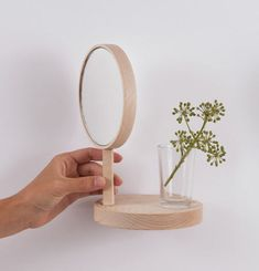 Balcon Collection by Inga Sempé: Belvédère is a classic wall shelf with a mirror that rotates.