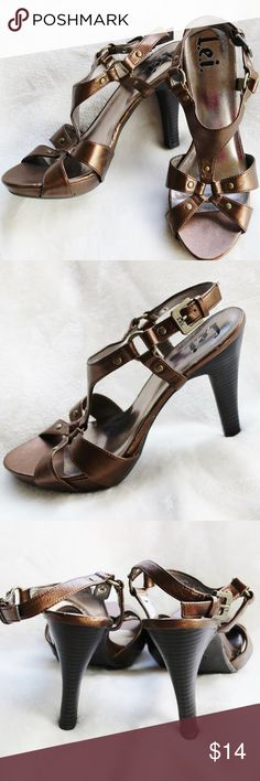 L.e.i. Bronze Sandals - Size 8.5 These are a great pair of classy looking sandals! They are in excellent condition! They have been very gently loved. The heel measures 4 1/2 inches high, however, there is a platform in the front that measures 1 inch. L.e.i. Shoes Heels
