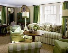 Green Living Room- I love the color scheme and the cozy feel.  I'm not one for the more modern, empty look, so I like this.  I'm no minimalist!  I love fabric, I love oaky wood, I love decorations. It somehow pulls off looking a little old-fashioned (which I love!), without looking dated, and while keeping a fresh aire about it.  It also pulls in a lot of rich color, while still looking bright, not dim. I'll have to keep this for a bit of inspiration.