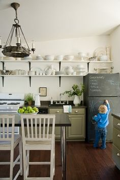 Paint the fridge to be a chalkboard.... love this idea, especially if you have an old fridge :)