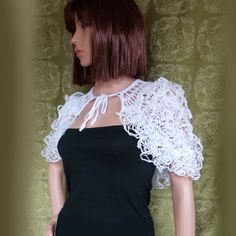 A charming bridal capelet , white wedding cape or for evening wear, knitted with acrylic/poliamid (80%/20%) ribbon yarn . This romantic lace cape is gentle and airy and will be beautiful complement for simple wedding gown. You can wear it over your evening dress , when You want to feel elegant and stylish . Very suitable accessory for a bridesmaid as well. This size fits all S-M-L. Length : 14.5 in /37 cm This one is READY TO SHIP. If the sizes and color are not suitable for y...