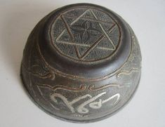 A beautiful century Ottoman brass drinking cup. To have the Seal of Solomon on the bottom of a drinking cup was quite common among Muslims. In the Arabian Nights, Sindbad presented Hārūn al-Rashīd with such a cup, on which the Seal was engraved. Solomons Ring, Solomons Seal, Seal Of Solomon, King Solomon, Prophets And Kings, Symbols Of Islam, Days Of Creation, Islamic World
