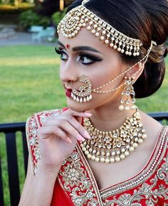 Bride in Pearl and polki jewelry | Photo Source - WiseShe.com & HappyShappy.com | Traditional Indian Bride | Indian Wedding jewelry | Bridal nose ring in kundan, crystals and pearls | Math patti in gold and pearls with two pearl chains | Bridal Portrait | More #nath ideas on #wittyvows #blog | #nosering #bridalnath #bridaljewellery #indianwedding #indianbride #weddingjewellery #pearl