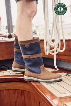 Setting sail this summer? Dubarry Ultima is all-leather, waterproof and fully breathable. Perfect for days spent on deck. ⛵️ . A unisex sailing boot, available in black, brown or the newly-added navy/brown (pictured) in both standard and ExtraFit options. . #dubarrysailingboots #dubarryboots #sailingboots #robinsonsshoes #sailing Dubarry Boots, Sailing Boots, Country Boots, Navy And Brown, Robin, Men's Shoes, Sons, Espadrilles, Deck