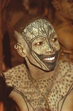 Africa    A Nuba from Kau with his painted face mask    © Leni Riefenstahl. by cheri