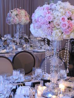 Fabulous floral centerpieces atop crystal stands. Posh Peony Floral and Event Design.