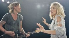 "Keith Urban and Carrie Underwood debuted the ""exclusive first look at [the] music video"" for their brand new single, ""The Fighter"". The video opens with Urban playing the opening riff on his electric guitar interlaced with fo Country Music Videos, Country Songs, Country Playlist, Music Like, My Music, Reggae Music, Dance Music, Keith Urban Lyrics, Dance Moves"