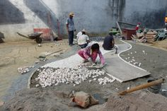 Labourers manually laying the tile stones to create the Portuguese style tile patterns in Macau (Sept 2014) - Photo taken by BradJill