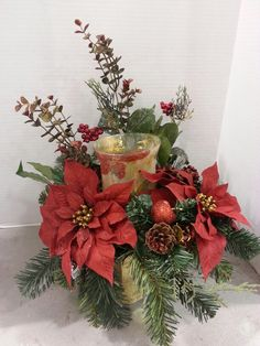 Red poinsettias and pinecone candle arrangement ( Christina)