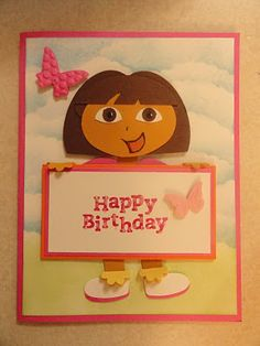 "Dora the Explorer punch art uses the following Stampin' Up punches. Heart to Heart: shoes and arms, Boho Blossom: hands and socks, Word Window: legs and neck, Small Tag: shorts, Small Oval: sleeves, Wide Oval: Hair and body, 1/2"", 1/4"" and 1/8"" circles: eyes and mouth, Scallop Oval: used as a mask for inking the clouds."