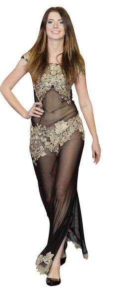 c1155785c0 Awangardowa czarna suknia wieczorowa. Uszyta z plastycznej siateczki  opinającej ciało. Na wysokości biustu i bielizny naszyte są złote ornamenty  które ...