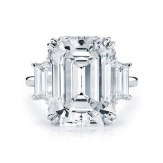 Kwiat 10.10ct emerald cut diamond ring with trapezoid side stones in platinum.
