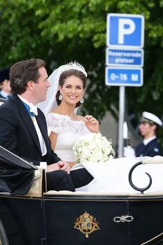 Christopher O'Neill and Princess Madeleine of Sweden are taken by horse and carriage from the Royal Palace of Stockholm to Riddarholmen after the wedding of Princess Madeleine of Sweden and Christopher O'Neill hosted by King Carl Gustaf XIV and Queen Silvia at The Royal Palace on June 8, 2013 in Stockholm, Sweden.