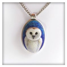 • White Owl Pendant •  A unique pendant for someone who either loves owls or collects one-of-a-kind wearable art.  Owl is carefully crafted from various types of wool by needle felting technique. Oval metal frame and chain are silver plated, lead / nickel free.  • Pendant size 6cm height / 3.5cm wide (2.2 inches height / 1.4 inches wide) * Chain is 80cm long (31.5 inches)  Comes in cosmetic jar for easy display and safe storage. • Jar size 5cm height / 7.5cm wide (2 inches height / 3 inches…