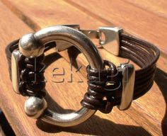 Hey, I found this really awesome Etsy listing at http://www.etsy.com/listing/92475694/unisex-men-women-brown-leather-bracelet