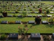 Een grasveld met vele grafstenen van oorlogsslachtoffers op de Kanchanaburi War Cemetery