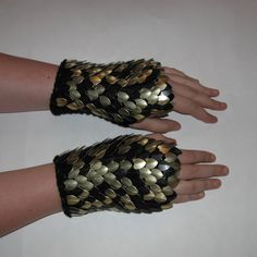 Hey, I found this really awesome Etsy listing at https://www.etsy.com/listing/120912723/scale-maille-gauntlets-knitted