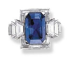 A SAPPHIRE AND DIAMOND RING, BY OSCAR HEYMAN BROTHERS Set with a rectangular-cut sapphire weighing 13.30 carats, within a baguette-cut diamond frame, to the trapezoid and rectangular-cut diamond shoulders, mounted in platinum With jeweller's mark for Oscar Heyman & Brothers. Art Deco or Art Deco style. by wteresa