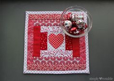 I haven't posted a mug rug tutorial for a while, so I felt that a cute Valentine's mug rug would be nice. This mug rug can be made with our without a heart in the center.  You will need the following