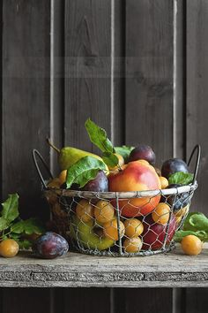 I like that the wire basket reveals the fruit at the bottom.  Again, loving the old, grey wood.
