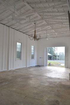 """white  faux """"board and batten"""" walls, ceiling fans and decorative lighting"""