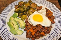 This sweet potato and chicken sausage hash is a great dish to make a big batch of to have on hand all week. All you have to do is throw it in the microwave!
