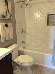 Classic & Casual Bathroom by BlankSpace LLC, Pittsburgh PA. Bathtub/Shower Combo with Matte White Subway Tile and Silver Emperador Accents.