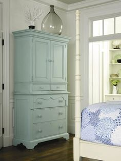 With the postage stamp size of most secondary rooms today, major furniture pieces need to do double duty. I like the idea of using a chest with drawers and upper storage. I would go with something like this in a sea grass (green).