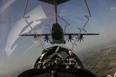 Airbus A400M Atlas in flight, taken from the backseat of a Red Arrows Hawk jet - The Royal Air Force demonstrated its global capabilities to 130,000 people at the Royal International Air Tattoo (RIAT).