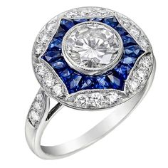 A vintage diamond and sapphire cocktail ring set in platinum or white gold.  The invisible setting of the sapphires is beautiful!  Great inspiration for your own custom creation.
