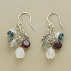 """NIGHT SKY EARRINGS--Ever-shifting shades of blue and gray and the warm glow of garnet give our exclusive dangling gemstone earrings a lovely understated beauty. They glow with moonstone, labradorite, garnet, blue topaz, and aquamarine. Sterling silver wires. Made in USA. Handmade. Approx. 1-3/8""""L."""