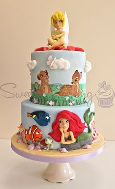 Disney Cake. It would be great for a baby shower. make all the characters look like they did when they were babies or toddlers