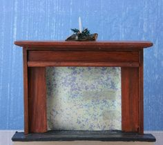 Make This Fireplace From Wood or an Inexpensive Piece of Dollhouse Furniture