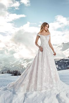 Off-the-shoulder ball gown wedding dress by Eddy K Sky Collection.
