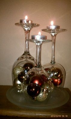 Beautiful fireplace mantle decoration...Christmas bulbs and wine glasses