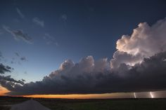 We chased this supercell for hours around the Olney, Texas area. The storm started to weaken and move away from us at sunset, still discharging lightning. We had the perfect view. A storm always refreshes the atmosphere, so the colors in the sky were so vibrant. This was one amazing sight! Hope you enjoy.