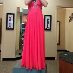 Beautiful pink prom dress Size 0 with a corset, I'm normally a 2 or 4. Only worn once! Dresses