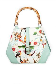 Banned Green Butterfly And Flowers Retro Handbag - If you are looking for a new accessory, look no further than the Green Butterfly and Flowers Retro handbag. Featuring a butterfly and flowers applique on the front, this bag will brighten up your life. It has a top carry handle and the zip opening reveals inner pockets, pen holders and an extra zip up secure pocket