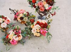 To try and tie in coloured bridal bouquet, we could use similar colour pallet to this for bouquet. The girls then carry white/cream/green and then flowers at reception are in the white/cream/gold/burgundy/green like the image we love.