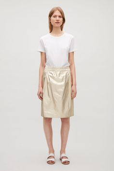 COS image 1 of Metallic coated cotton skirt in Gold