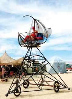 illuminati style raised triangle bike at burning man