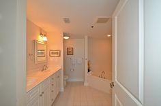 Corner bathtub opposing corner sinks